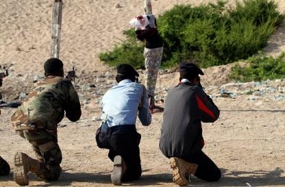 Somali government soldiers execute Abdi Sheikh by shooting at close range at the Iskola Bulisiya square in Somalia's capital Mogadishu